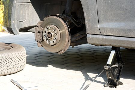 vehicle wheel removed car on a lift wheel replacement