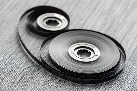 Compact audio cassette tape reels concept closeup
