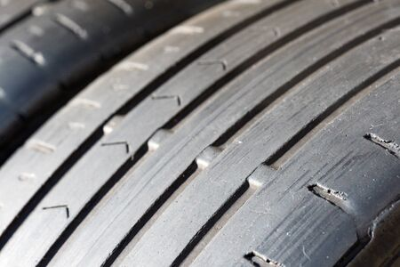 worn out tyre tread wear indicators closeup. the tyres tread has clearly worn down to the legal limit. Stock fotó