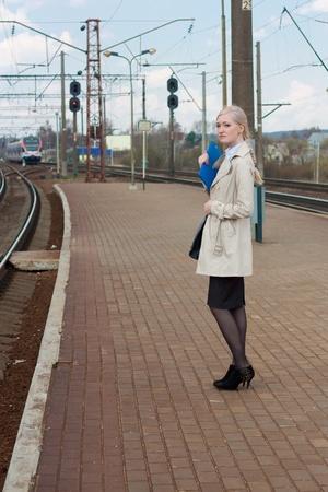 railtrack: Girl waiting for the train Stock Photo