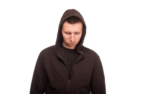 Young man in a hoodie looking down Stock Photo - 20281744