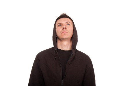 Young man in a hoodie looking up Stock Photo - 20281743