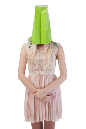 young woman with shopping bag on the head, isolated on white background photo