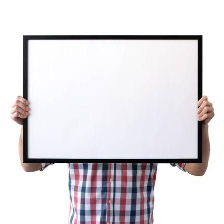 Holding frame mockup. Photo Mockup. The man hold frame. For frames and posters design. Foto de archivo - 133315836