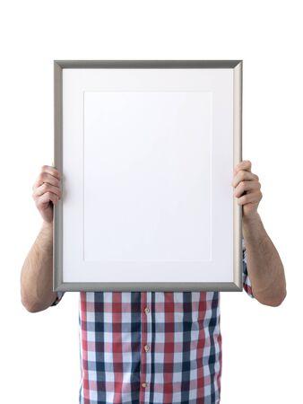 Holding frame mockup. Photo Mockup. The man hold frame. For frames and posters design. Foto de archivo - 133315832