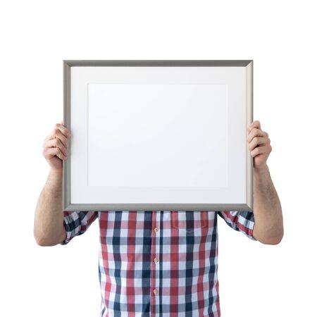 Holding frame mockup. Photo Mockup. The man hold frame. For frames and posters design. Foto de archivo - 133315838
