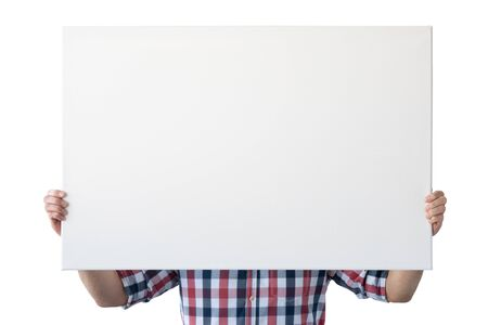 Holding canvas mockup. Photo Mockup. The man hold canvas. For frames and posters design. Foto de archivo - 133315844