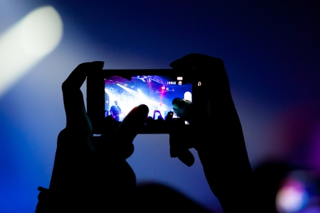 luce: Concert video recording with cell phone Stock Photo