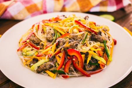 korean salad: Korean Noodle Salad. Funchoza on the wtite plate