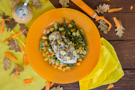 garnish: Turkey with Provence herbs with garnish on the wooden table Stock Photo