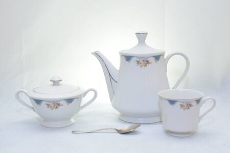 Mock up / design set of elegant and traditional teapot colorful white and blue coffee cup & Tea cup on cup's plate beside the hot tea pot , design/ drink-ware / Serveware / Soup isolated on white background