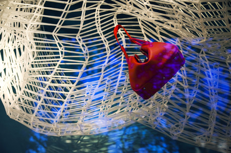 luxuries: Handbag hanging on a display rack
