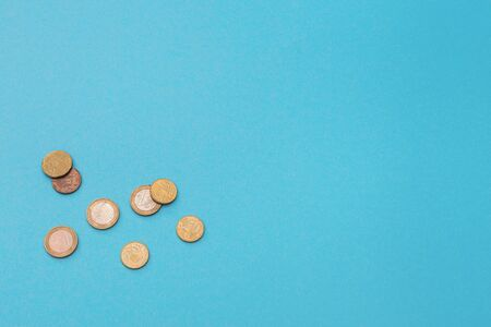 Euro coins on a blue background