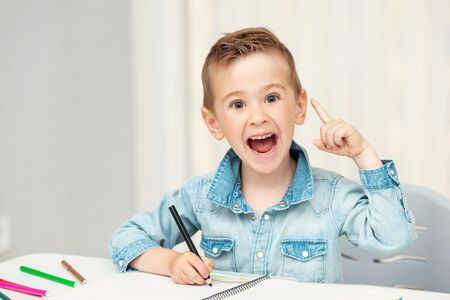 Little Preschool Boy Reacts Emotionally. Creative boy Фото со стока