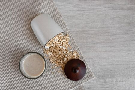 Non dairy alternative milk in a glass with oat seeds