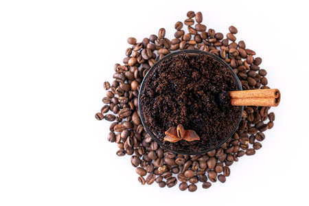 Natural eco body coffee scrub on coffee beans on a white background. Homemade spa cosmetic. Top view