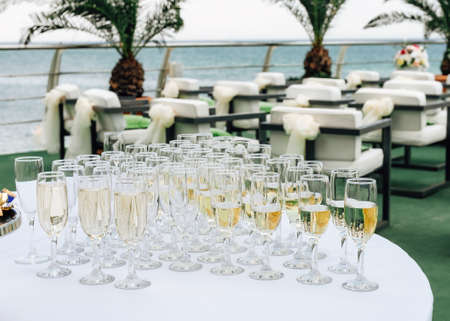 Glasses with wine and champagne on table. Selective focus