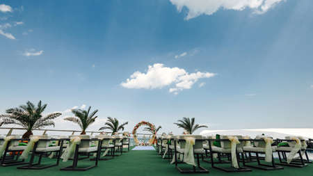 Beautiful Wedding ceremony event arranging at beach against sky