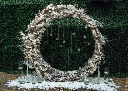 Wedding round arch decorated with beautiful white orchid
