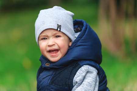 Portrait of toddler boy with angry upset face expression Foto de archivo