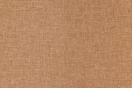 Texture canvas fabric as background light brown. Small texture. Rough linen material