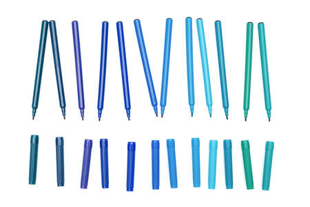 Various of blue colored markers pens with cap off on isolated background. Different shades of blue color. Design and creativity concept