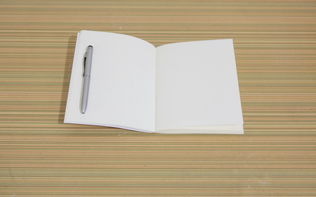 dhesive note: notebook on wooden table Stock Photo