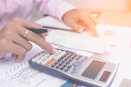 Close up accountant or banker making calculations. Savings,Concept finances and economy