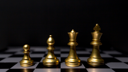 action fund: Business leader concept. Chess board game competition. Stock Photo