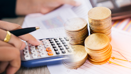 speculation: Concept of currency trading.Businessman calculate working is examining a technical chart of financial instrument. making a decision for an optimal gain. Business and finance concept.