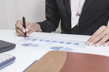 information analysis: Businessman check seriously analyzes a finance report investor colleagues discussing new plan financial graph data. bank managers task. Concept business and finance ,Account analyzes planing