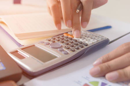 Businesswoman calculate about cost and doing finance at home office, Finance managers task,Concept business and finance