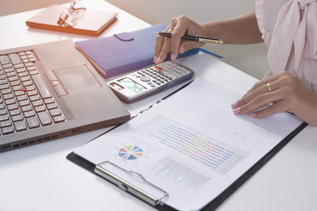 Business person analyzing financial statistics graph on the paperwork Stock Photo