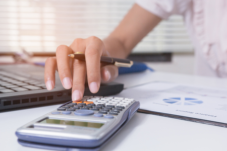 Businesswoman calculate about cost and doing finance at home office, Finance managers task,Concept business and finance investment