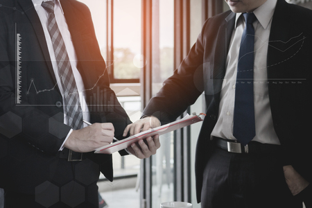 trusted: Business team present and discussing plan financial graph data on office table, finance, accounting, investment, meeting. Stock Photo