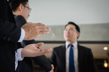 trusted: Businessman breaking hands with the team business partner, Businessman shaking hands to seal a deal with his partner.