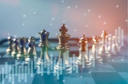 ビジネスのアイデア、競争や協同計画成功意味、株式金融統計グラフ分析データ概念のチェス ボード ゲーム コンセプト。 写真素材