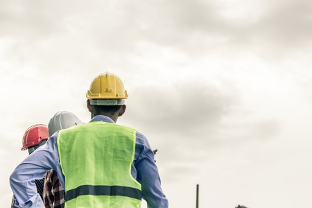 Engineer pointing orders for worker team to work safety