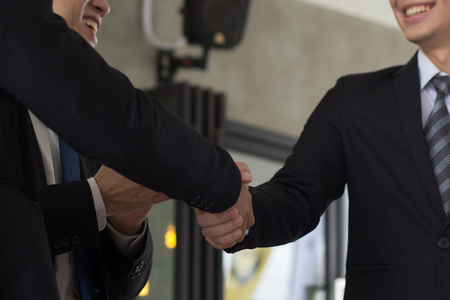 Business handshake and business people connection deal concept, Group businessman is is enjoying with new project start up.