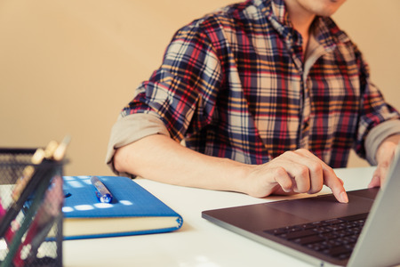 Businessman hands busy using laptop at office desk, young female student typing on computer sitting at wooden table