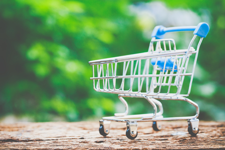 Shopping online concept, The trolley on wood. Customer can buy everything from office or home. Stock Photo