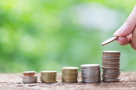 Investment and financial concept, Close up of stacking coins of growth to profit finance. Stock Photo