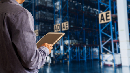 Businessman manager using tablet check and control for workers with Modern Trade warehouse global business commerce concept or import-export commercial logistic. Industry 4.0 concept Stock Photo