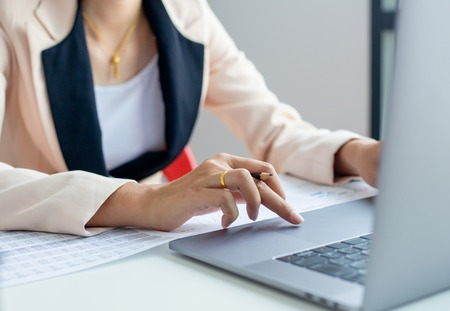 Businessman hands busy using laptop at office desk, young female student typing on computer sitting at wooden table Imagens
