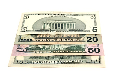 Miscellaneous denominations of dollars on white background photo
