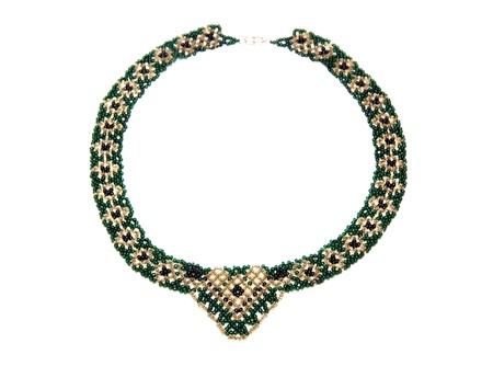 A beautiful necklace of green and gold beads photo