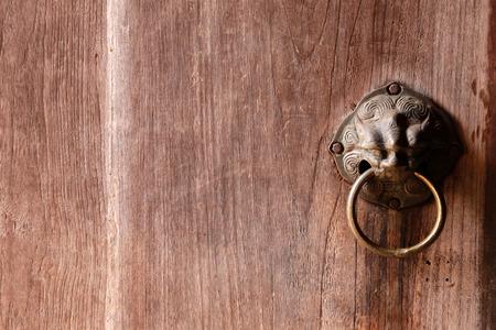Old wooden door with handles door  in vintage Chinese style.