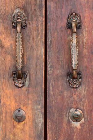 door handle: Old wooden door with antique door handles. Stock Photo