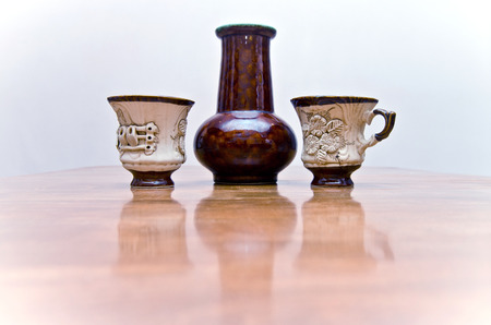 tableware life: Clay jug and two cups of handmade Stock Photo