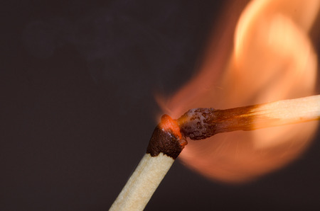 ignite: Two burning matches  one matchstick will ignite another